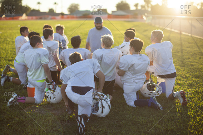 Huddle at a football practice with coach