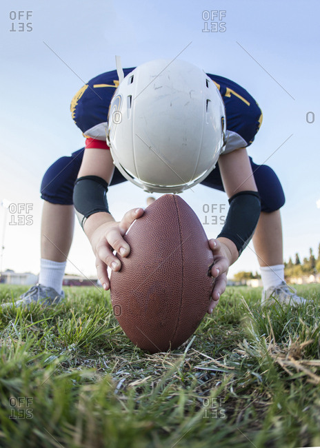 Boy playing football as center