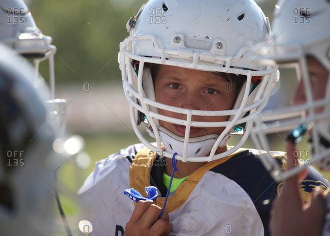 Close up of boy in a football helmet