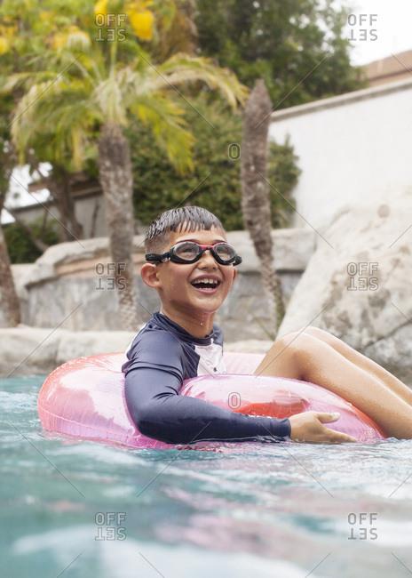 Boy in an inner tube in the pool