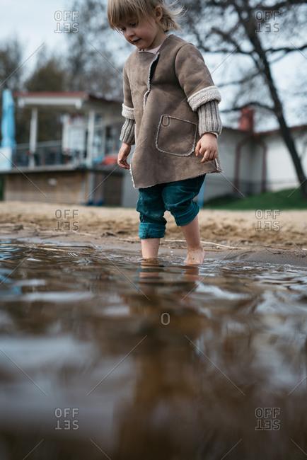 Girl wading in a lake