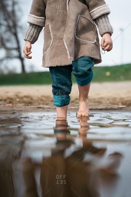 Girl walking in a shallow lake