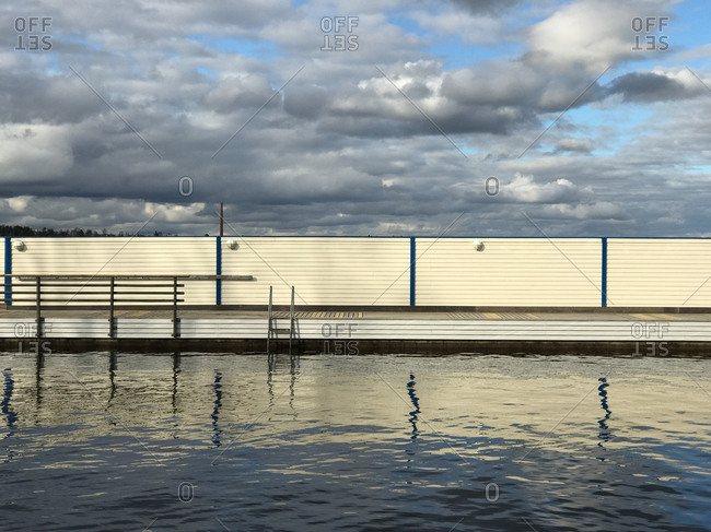 Jetty on a lake with ladders