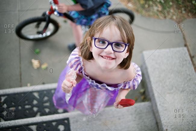Girl eating popsicle on steps