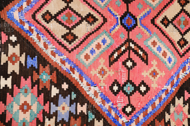 Close up detail of colorful patterned rug