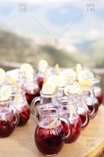 Pitchers filled with red juice and lemon slices