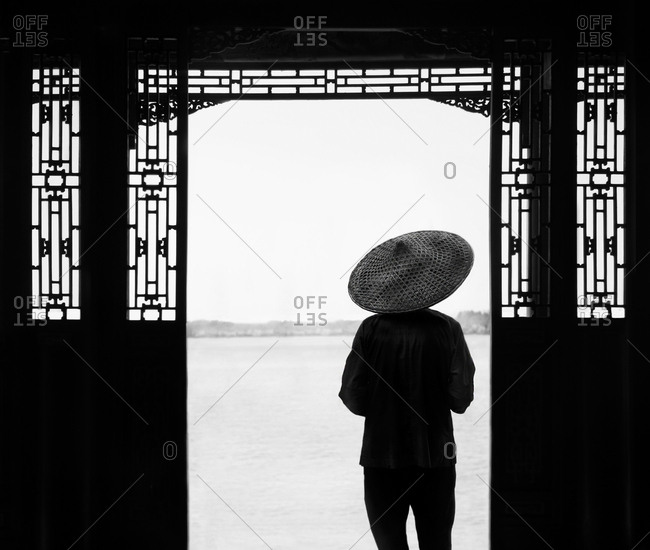 Person in hat at summer palace, Beijing, China