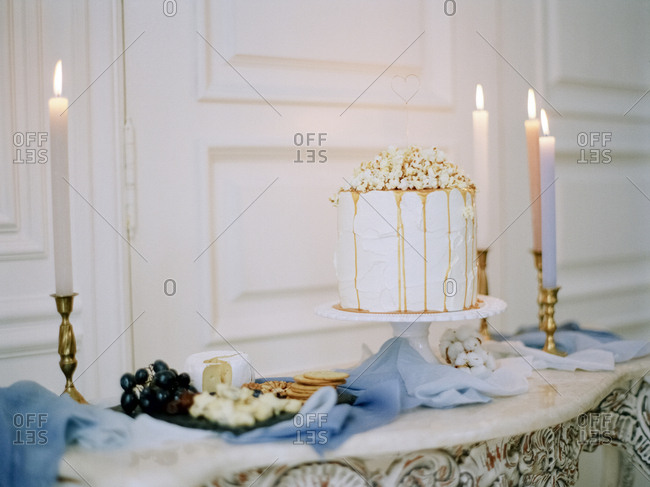 Cake and snacks by tapered candles