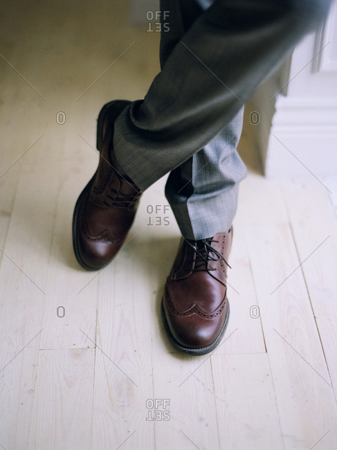 Feet of man in suit and formal shoes
