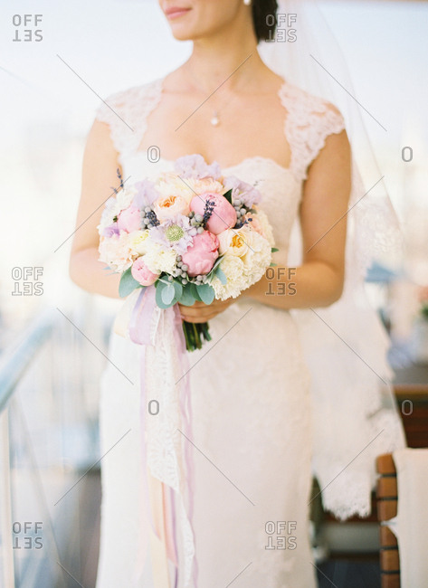 Bride in gown with wedding bouquet