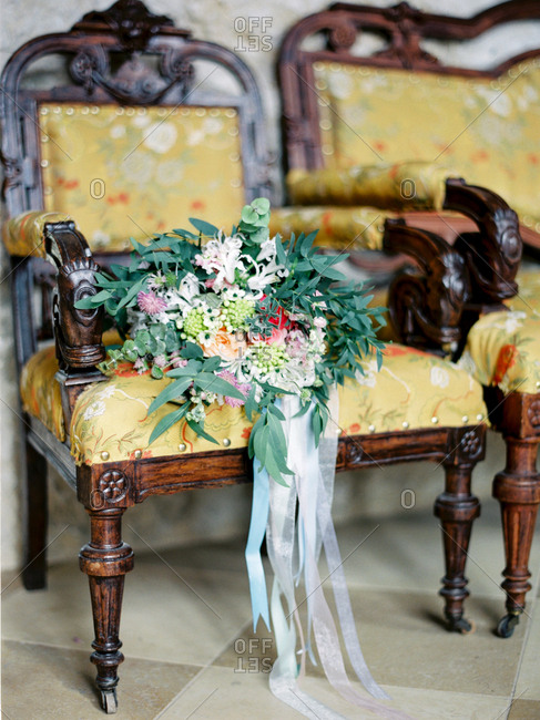 Flower bouquet in antique armchair