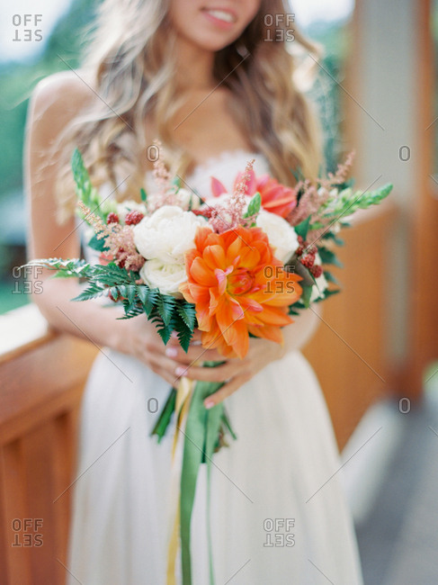 Bride holding her ornate bouquet