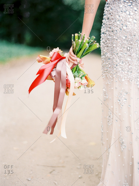 Bride with bouquet by her side