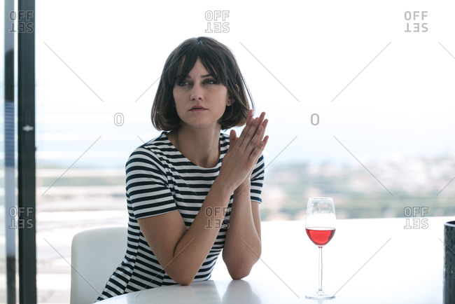 Women sitting at a table staring pensively