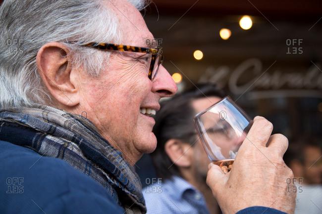Senior man drinking wine