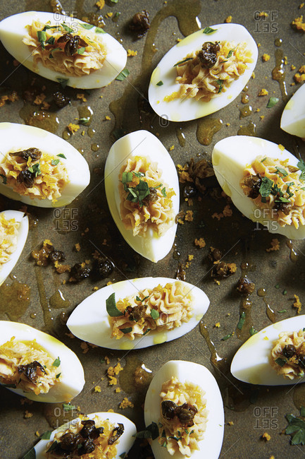 Deviled eggs tomato with bottarga and crispy capers