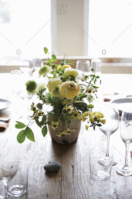 Floral arrangement on wood dining table