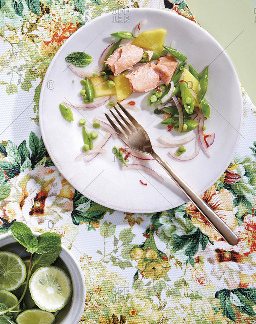 Sous vide salmon with snap pea and mango salad