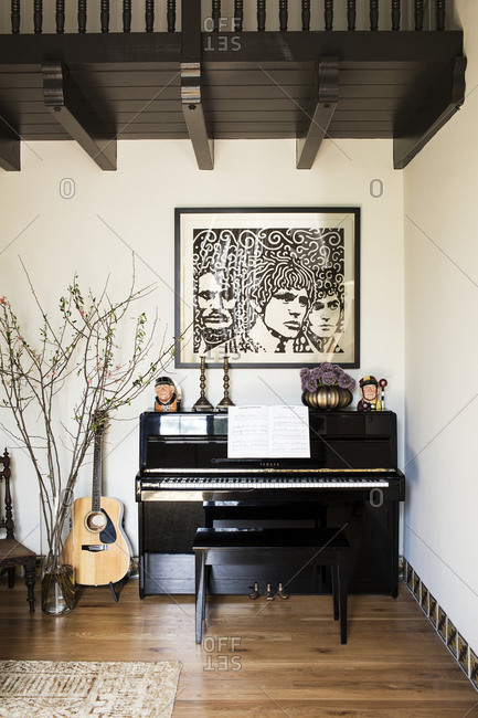 Los Angeles, California, USA - February 26, 2016: Piano and guitar in living room