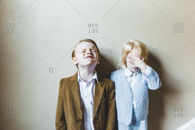 Two kids with stressed out looks on their faces