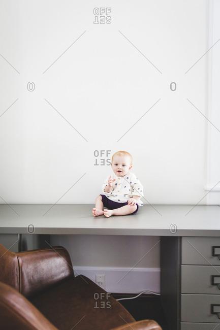 Baby sitting on office desk