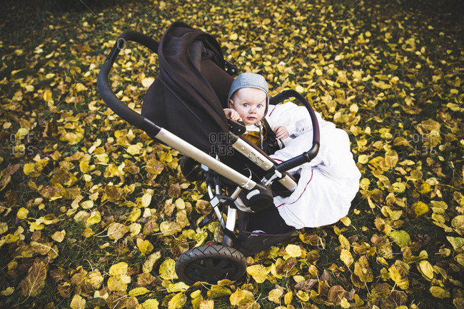 Baby outside in a stroller on a fall day