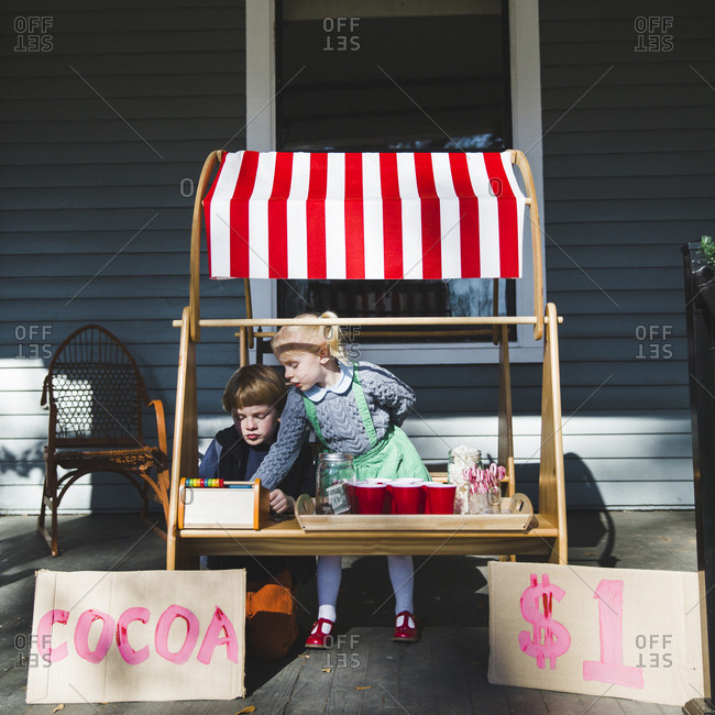 Two kids selling hot cocoa
