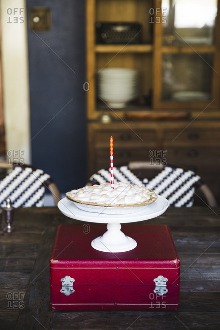 Birthday pie with one candle
