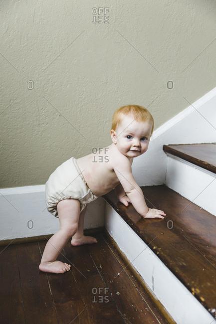 Baby girl climbing stairs