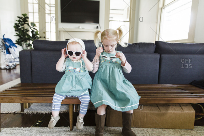 Two little girls wearing matching outfits