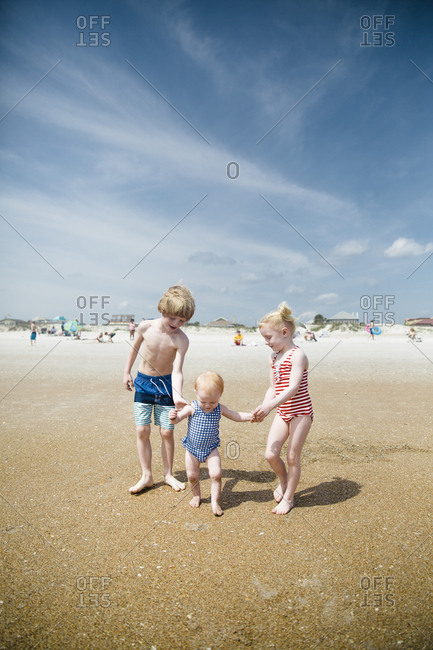 Three siblings on a beach in Saint Augustine, Florida