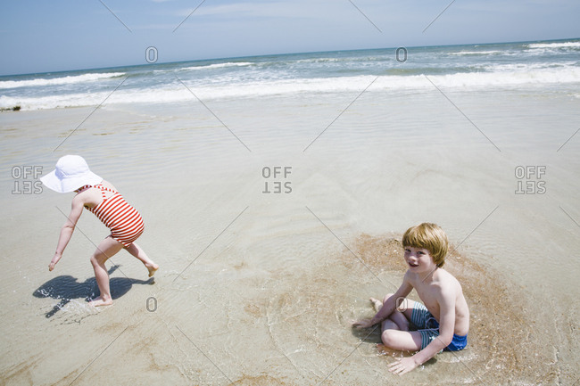 Two little kids on a beach in Saint Augustine, Florida