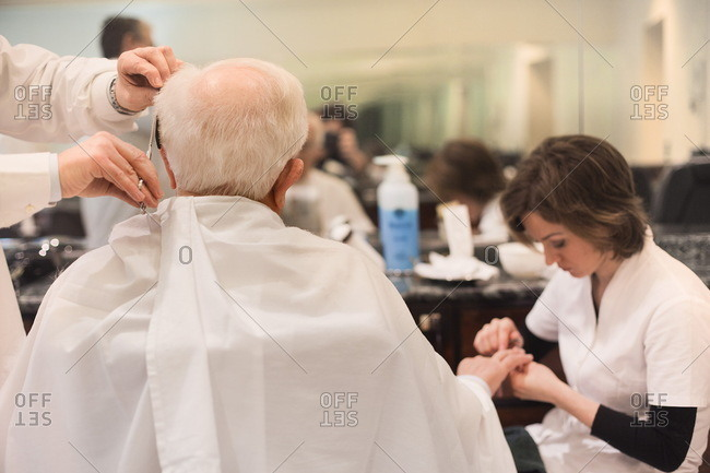 Naples, Italy - June 7, 2017: Man getting hair and nails trimmed