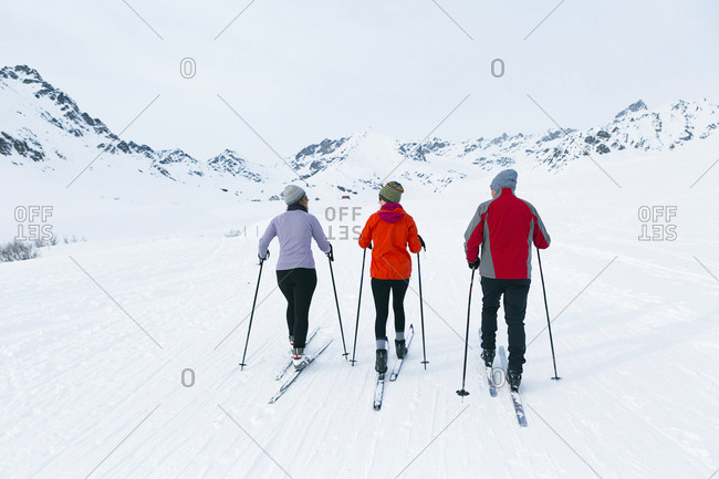 Parents with adult daughter cross country skiing