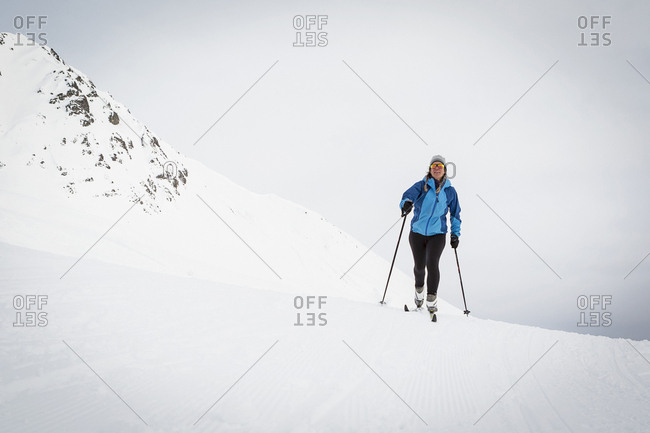 Woman cross country skiing in wide open environment