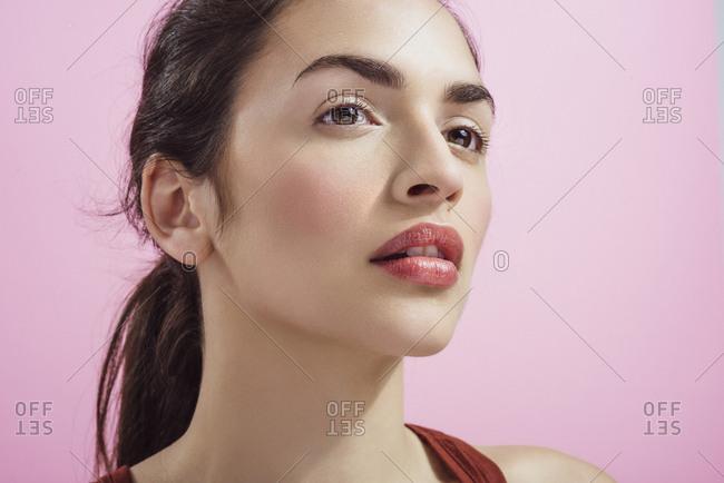 Woman with fresh skin natural makeup lip gloss