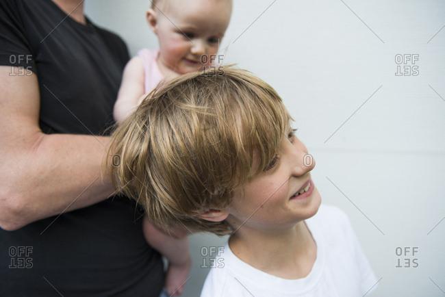 Baby sister pulling big brothers hair
