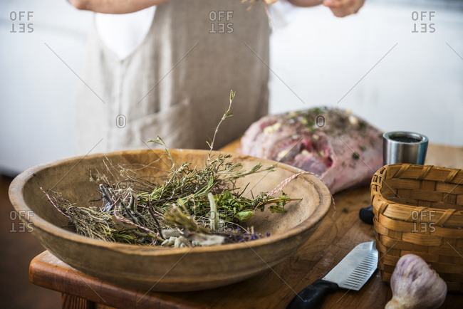 Detail shot of home gardened herbs in a large wooden bowl