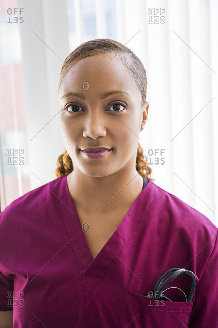 Portrait of confident female nurse with stethoscope in her pocket