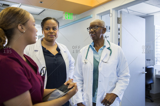 Multiethnic female doctors and nurse having discussion in hospital