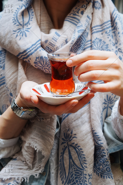 Woman holding tea glass in Istanbul