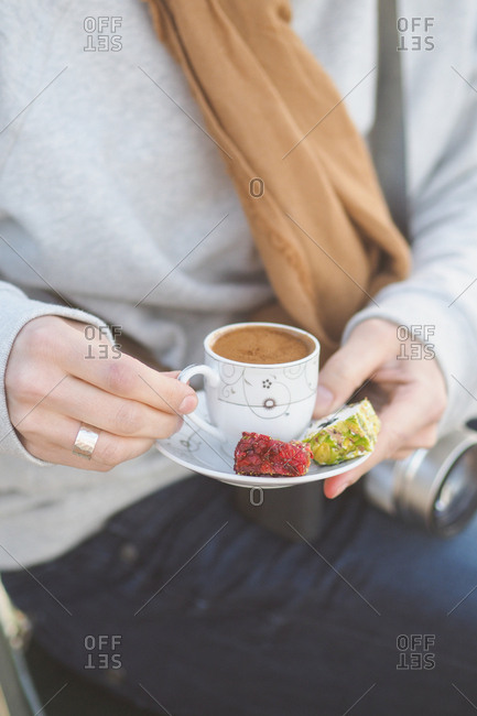 Woman with coffee and treats