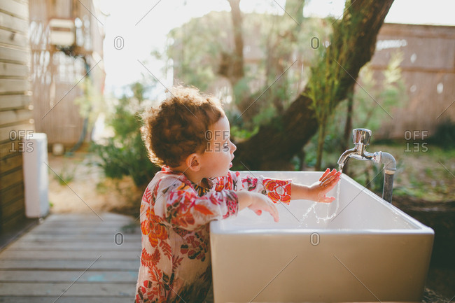 A girl washing her hands