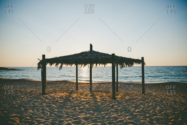 A beach hut at sunset