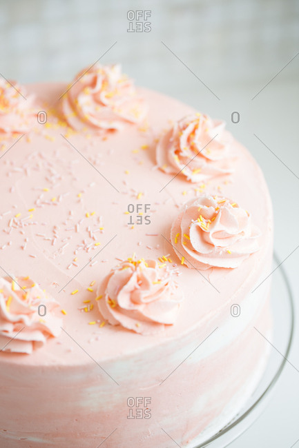 Pink cake with yellow and white sprinkles