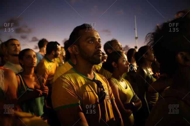 June 17, 2014 - Salvador, Brazil: Brazilian soccer fans watching World Cup at dusk