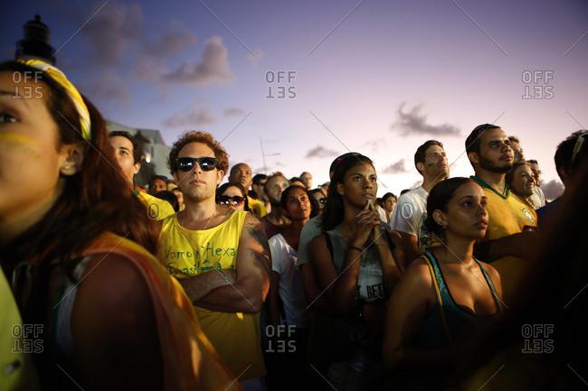 June 17, 2014 - Salvador, Brazil: Rapt soccer fans watching World Cup at dusk
