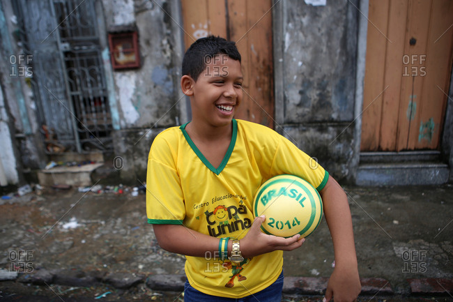June 12, 2014 - Salvador, Brazil: Young Team Brazil fan with soccer ball during World Cup