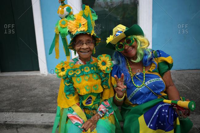 June 13, 2014 - Salvador, Brazil: Two senior women wearing costumes in colors for Team Brazil