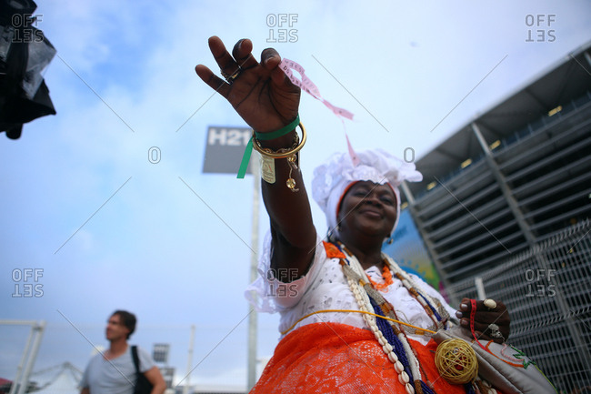 June 13, 2014 - Salvador, Brazil: Woman holding strip of paper at World Cup